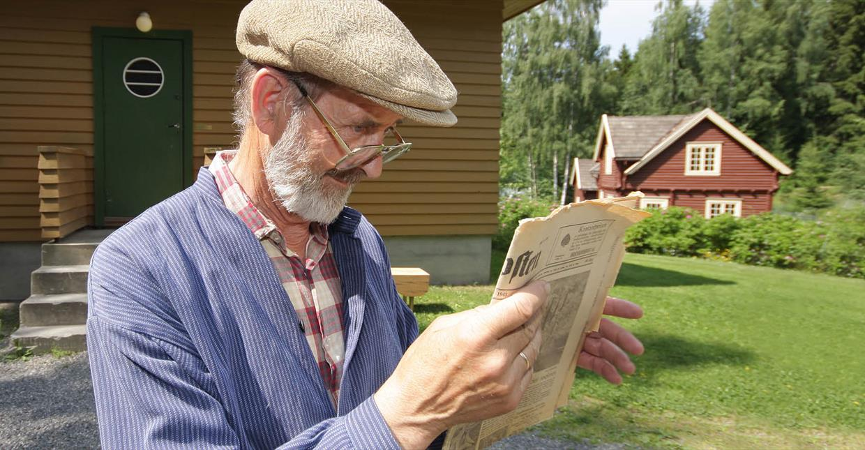 Man Reading newspaper in Maihaugen