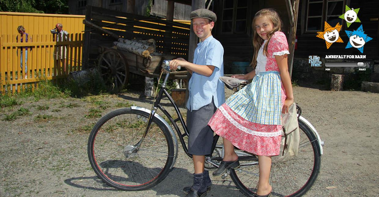 Children on bike at outdoor museum Maihaugen