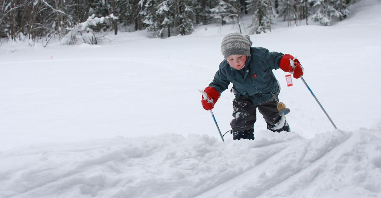 Child playing on cross country skis, authentic feel